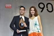 """90+ Logo"" designer Jason KWAN and Joey YUNG took a photo on stage."